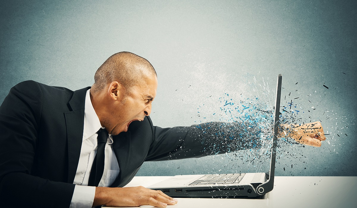 Concept of stress and frustration of a businessman with laptop